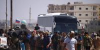 جنوبی شامی شہر درعا سے باغیوں کا انخلا