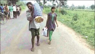 An Indian Cput Wifes Dead Body On His Shoulder And Walk