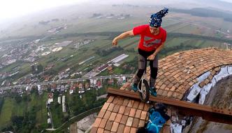 Unicycle On Huge Chimney