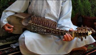 Pakistani Man Playing Traditional Rubab Instrumen