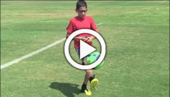 American Kid Solve Rubik Cub While Juggling