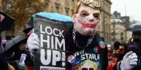 Protesters Confront President Trump In Paris