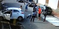 Couple Knocked Over By Toppling Garage Door