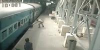 Hero Policeman Saves Woman From Slipping Under Moving Train