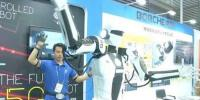 Robots Draw Attention At China High Tech Fair