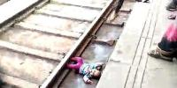 Girl One Miraculously Escapes Unharmed After Falling Underneath A Moving Train