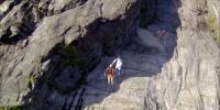 Daredevils Stunning Base Jump Down Cliff Face In Norway