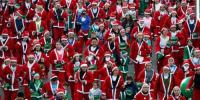 Thousands Dress Up Like Santa For Annual Charity Run In Paris
