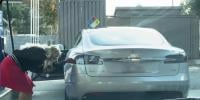 Woman Try To Put Petrol In Electric Car In Us
