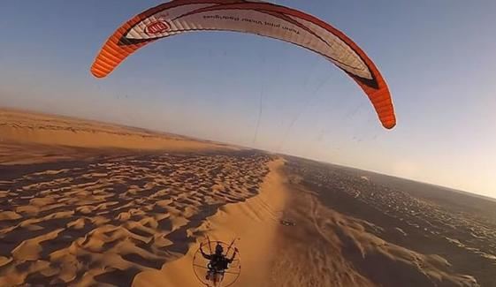 Daredevil Soaring Across The Skies Of Oman By Paramotor