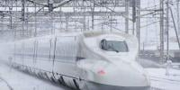 Japanese Train On Snow Tracks