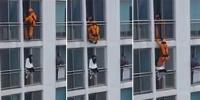 Firefighter Kicks A Man Off The Ledge Of The Balcony