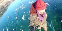 Russian Man Films Mesmerizing Walk Across Worlds Deepest Frozen Lake