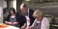 Prince William Chops Carrots As He Prepares Food At Homeless Charity