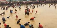 Daring Festival Goers Catch Fish By Hand In Vietnam