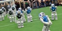 Falling And Scoring Robots Compete On Football Pitch