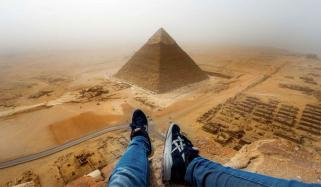 Daredevils Performing Dangerous Sky Diving Stunt Over The Pyramid Of Egypt