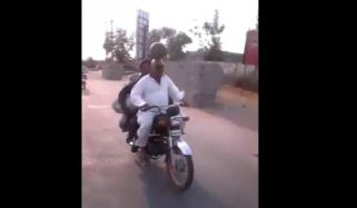 Man Riding Bike Balancing Watermelon On His Head In Pakistan