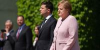 Angela Merkel Seen Shaking In A Ceremony In Berlin