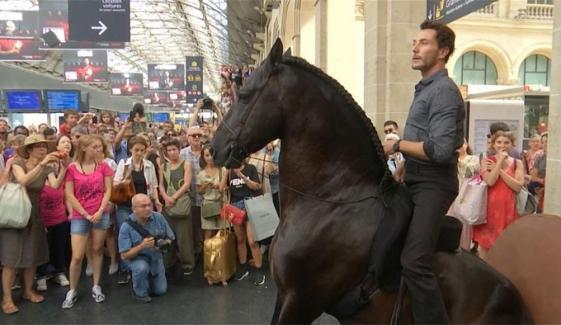 Performers On Horseback Surprise Passengers At Paris Train Station