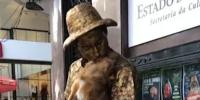 Clever Dog Stays Perfectly Still In A Street Entertainers Arms As They Perform Living Statue