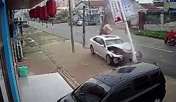 Car Crashes Into Utility Pole Sending Sparks Flying Onto Road In China