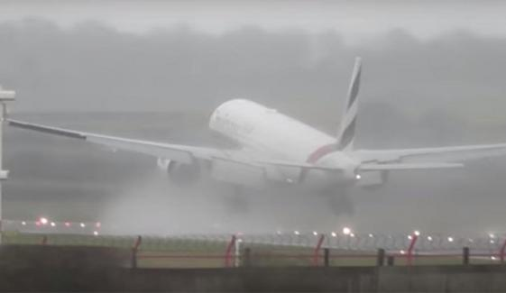 Moment Emirates Plane Is Forced To Abandon Its Landing Take Off Again In Crosswinds Uk