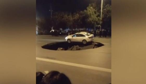 Car Left Overhanging Sinkhole That Opened Up On Chinese Road