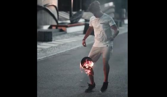 Norwegian Freestyler Extinguishes Flaming Football With Dazzling Kick Up Tricks