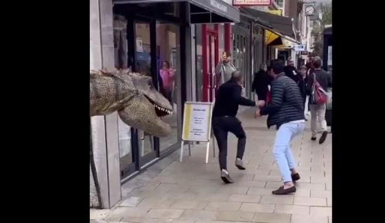 Jurassic Prank Hilarious Moment Joker In A T Rex Costume Sparks Panic In London