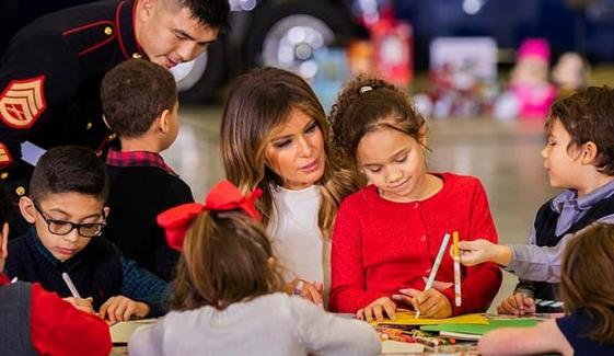 Melania Hands Out Gist To Children At Toys For Tots Holiday Drive
