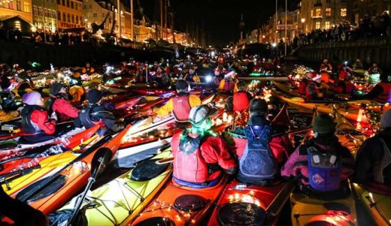Kayaks Canoes Light Up Dark Winter Night In Copenhagen