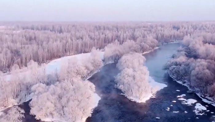 چین میں ہر سو پھیلی برف کے حسین نظارے