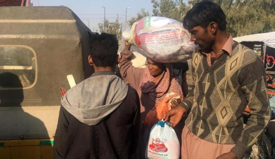 Relief Goods Distribution In Teen Hatti Fire Affectees