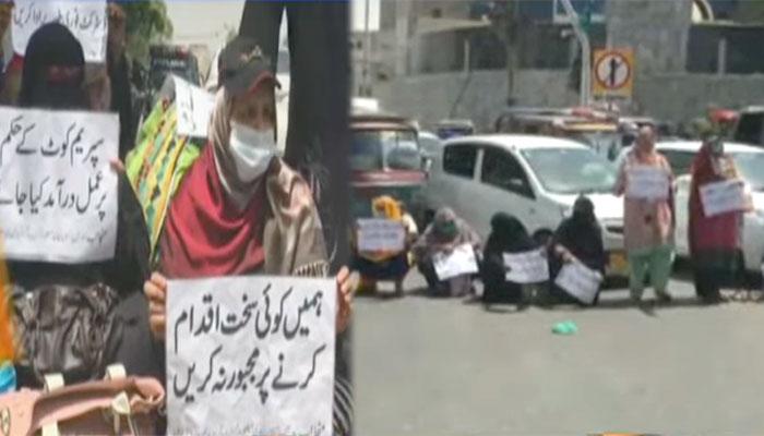 کراچی: لیڈی  ہیلتھ ورکرز نے اہم شاہراہ پر دھرنا دیدیا
