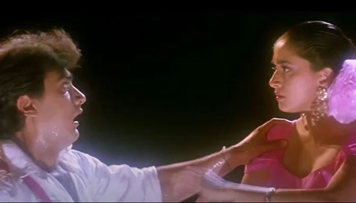What did Aamir Khan do to get Madhuri to run after him with hockey?