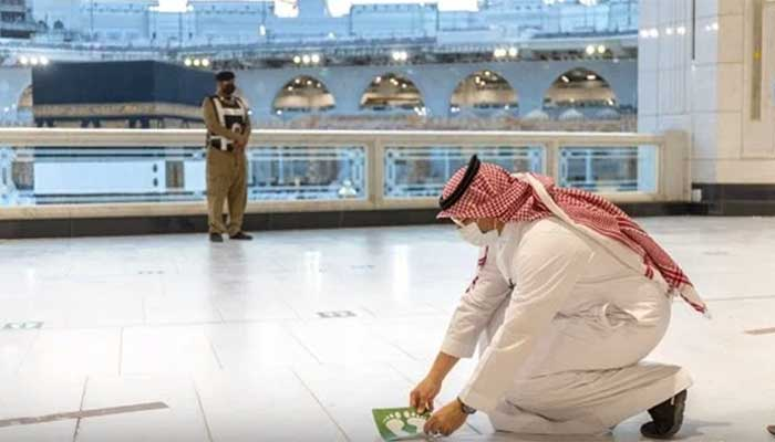 Social distance stickers have been re-arranged in Haram Sharif