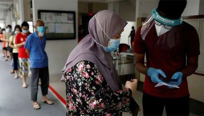 سنگاپور میں کورونا کے کیسز میں اضافہ، آئندہ ہفتے سے پابندیوں میں سختی کا اعلان